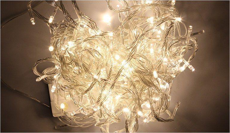 Lampki dekoracyjne choinkowe 100 LED ciepłe białe z programatorem na łańcuchu zdjęcie 4