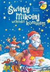Święty Mikołaj wchodzi kominem Mariusz Niemycki