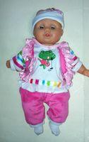 Lalka bobas mówiący i śpiewający w kolorowym ubran