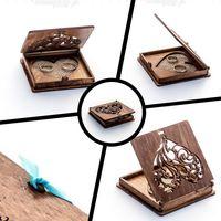 Pudełko a obrączki z możliwością przewiązania wstążką.