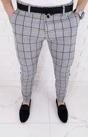 Jasnoszare eleganckie spodnie meskie slim fit w duza czarna krate 64J - 33